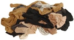 Mehrere Strumpfhosen liegen auf einem Haufen