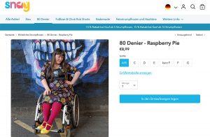 PR-Foto Snag Tghts mit Frau im Rollstuhl